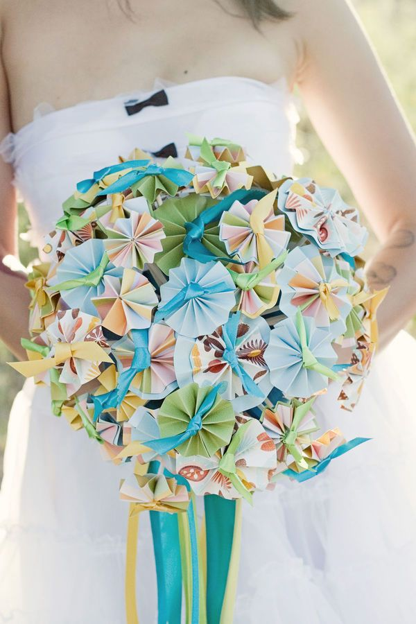 Paper flowers. it'd be nice as center pieces if you have hay fever like myself.
