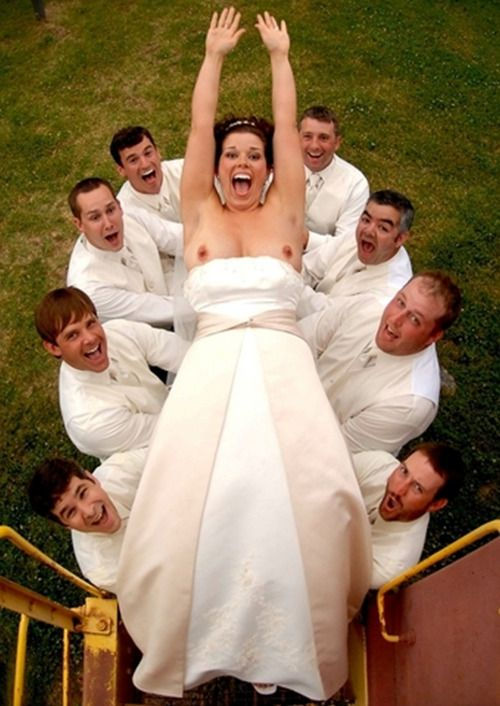LMAO  To all brides in strapless gowns, when the photographer suggests this pose, just say no...love the expression on the 3rd guy on the left.
