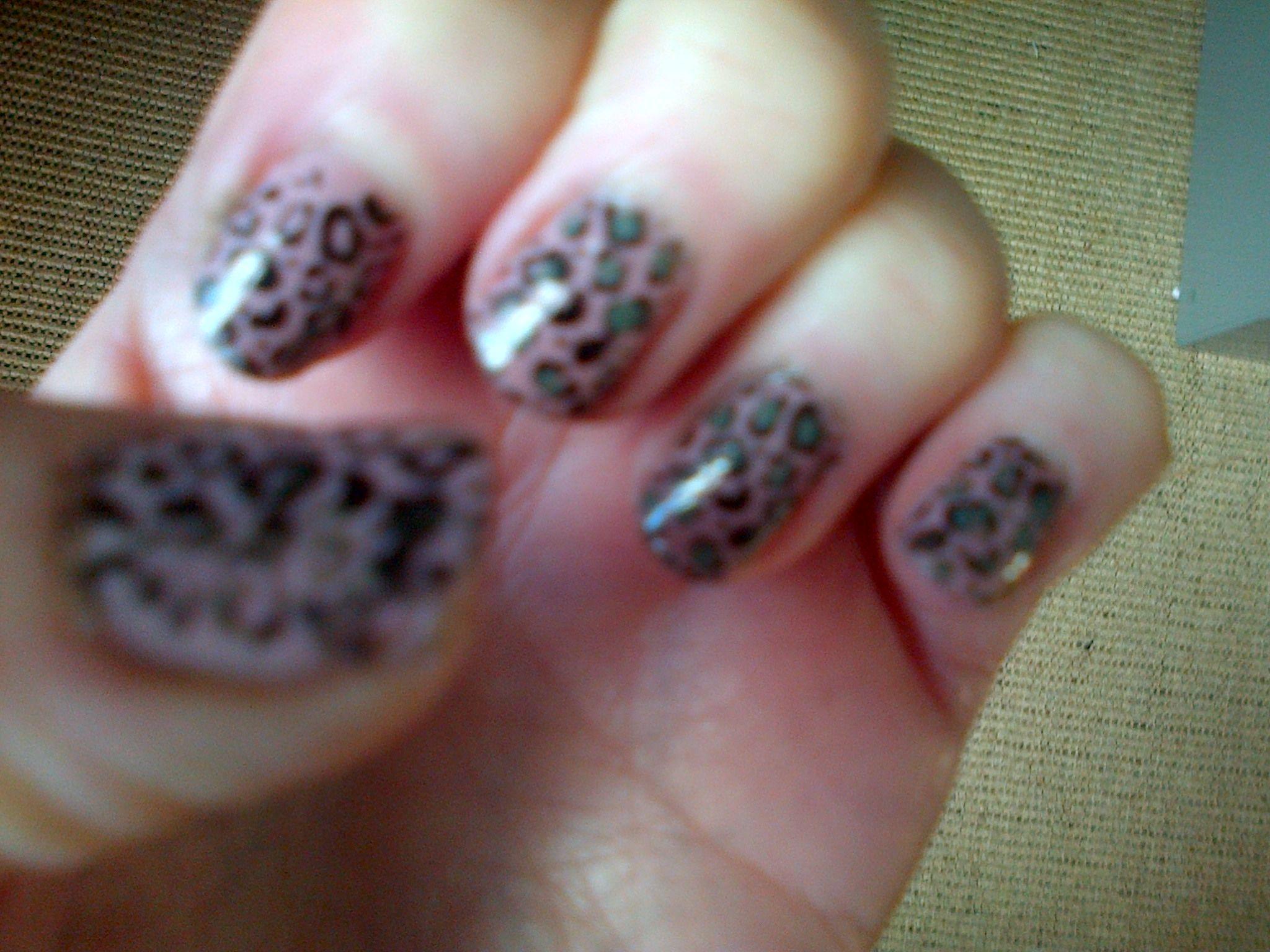 Leopard skin using konad stamper and dotting tool nail art
