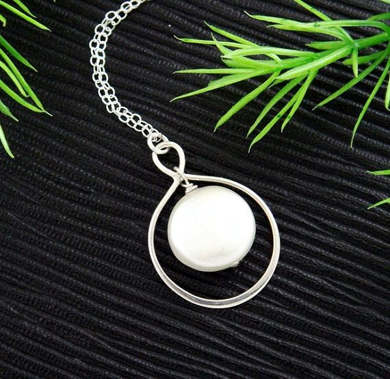 Hey, I found this really awesome Etsy listing at https://www.etsy.com/listing/111549477/infinity-pearl-pendant-necklace-big