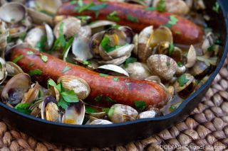 Clams and Chorizo Serves 2 2 links of chorizo 2 pounds clam, scrubbed clean under running water 2 tablespoons extra virgin olive oil 3/4 cup dry white wine 2 tablespoon...
