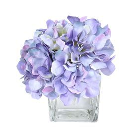 """Add a touch of organic inspiration to your home decor with this lush faux floral arrangement.  Product: Faux floral arrangementConstruction Material: Silk and glassColor: PurpleDimensions: 7"""" H x 8"""" W x 8"""" DCleaning and Care: Dust with a dry cloth"""