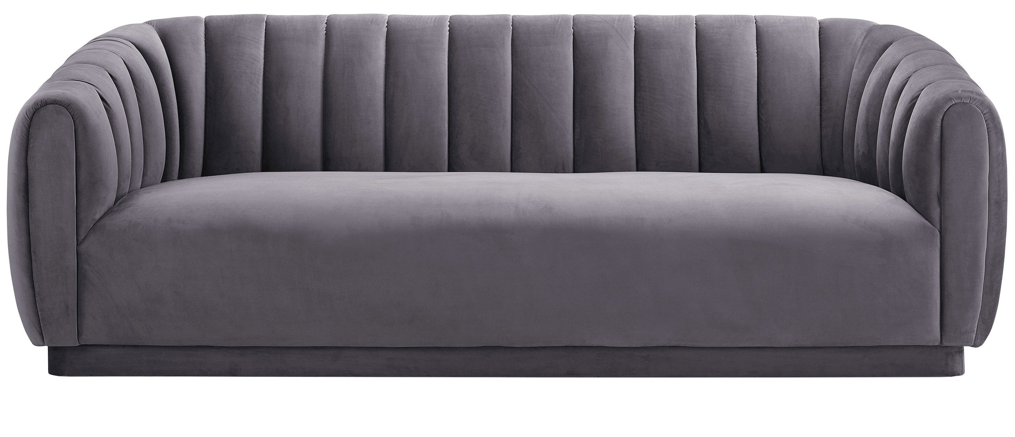 A single cushion and vertical tufting create an open invitation to sit down and relax in