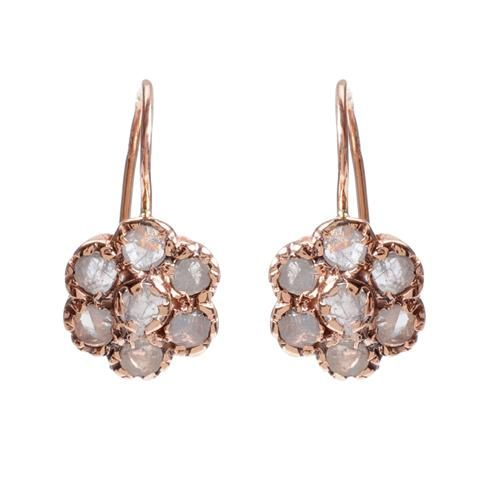 6cffe238a Arik Kastan's raw diamond floral earrings are crafted from his own blend of