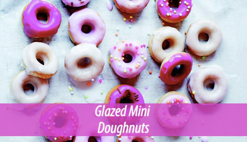 These mini doughnuts have a cartoon-ish air about them. You will have much fun dipping them in different colored glazes and sprinkles.  #delicious #recipes #EasyRecipes #desserts #healthyfood  #healthyeating