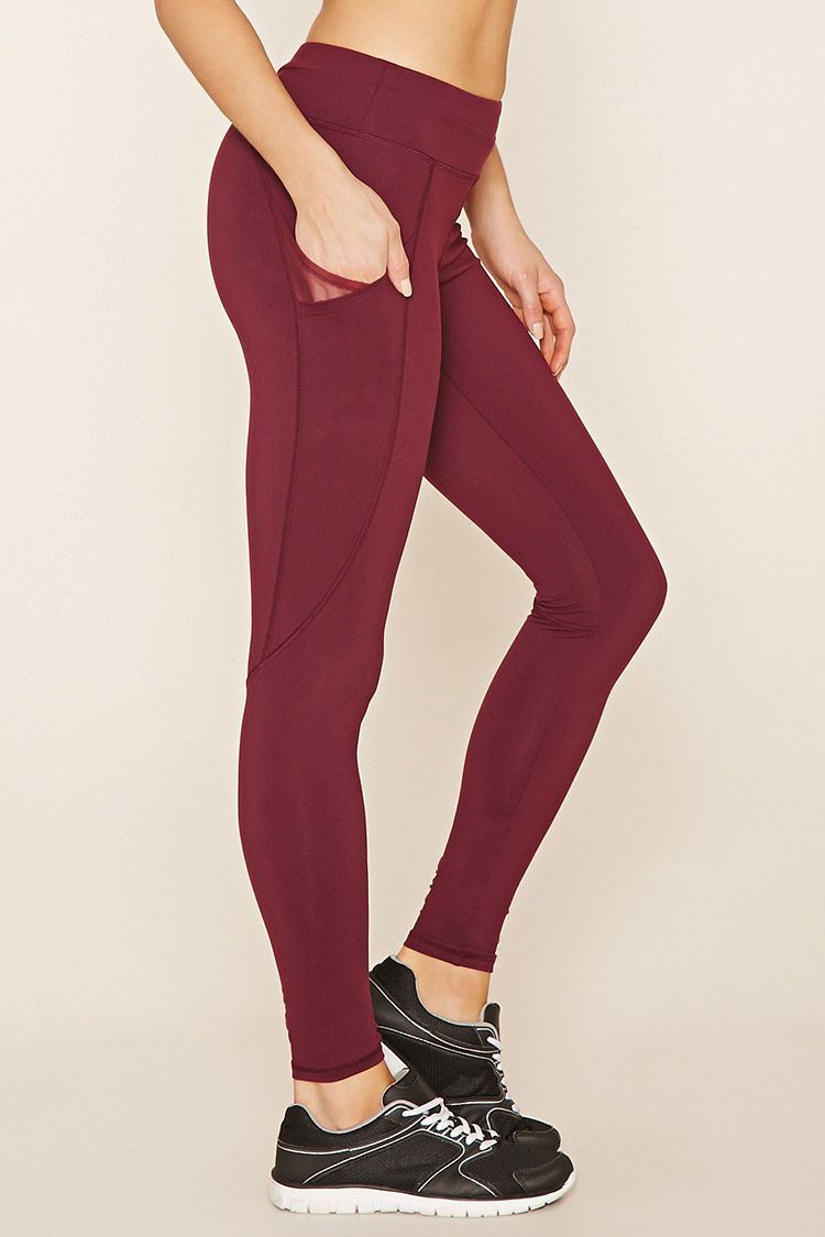 A Pair Of Athletic Leggings Featuring Side Pockets A