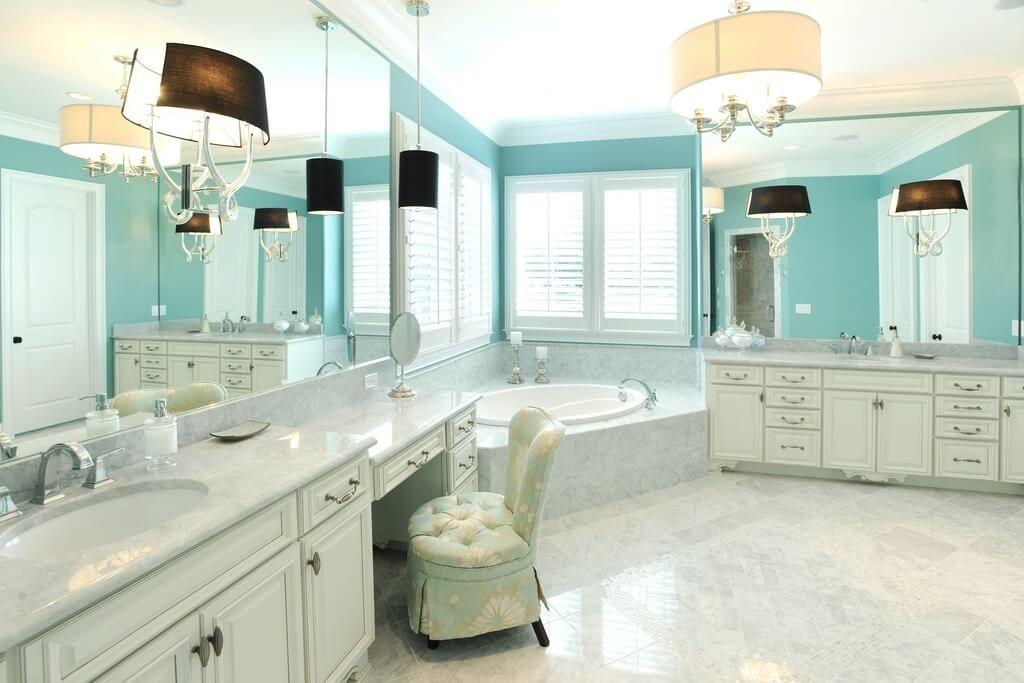This Spacious Luxurious Bathroom Has Two Separate Vanities With A Marble Enclosed Bathtub Between The Each Vanity Single Sink