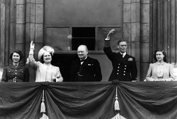 1945  King George VI and Winston Churchill, who became close friends during WWII, appear together on balcony during Victory Day celebrations