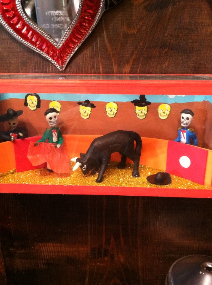 Found this in Chicago. Little box with a still scene in it! I love day of the dead. Great idea