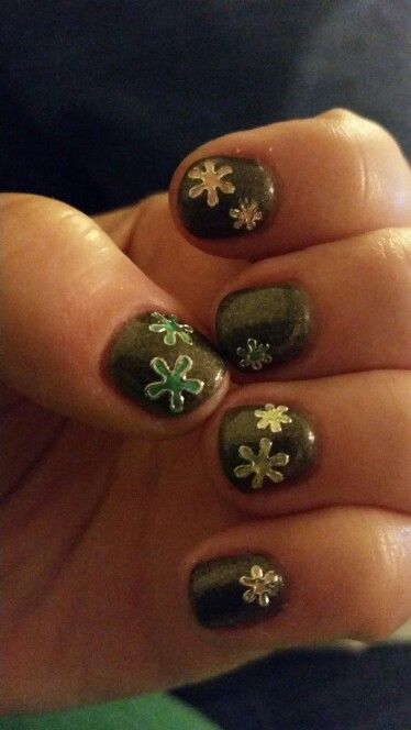 Dark gray nails with colorful flowers.