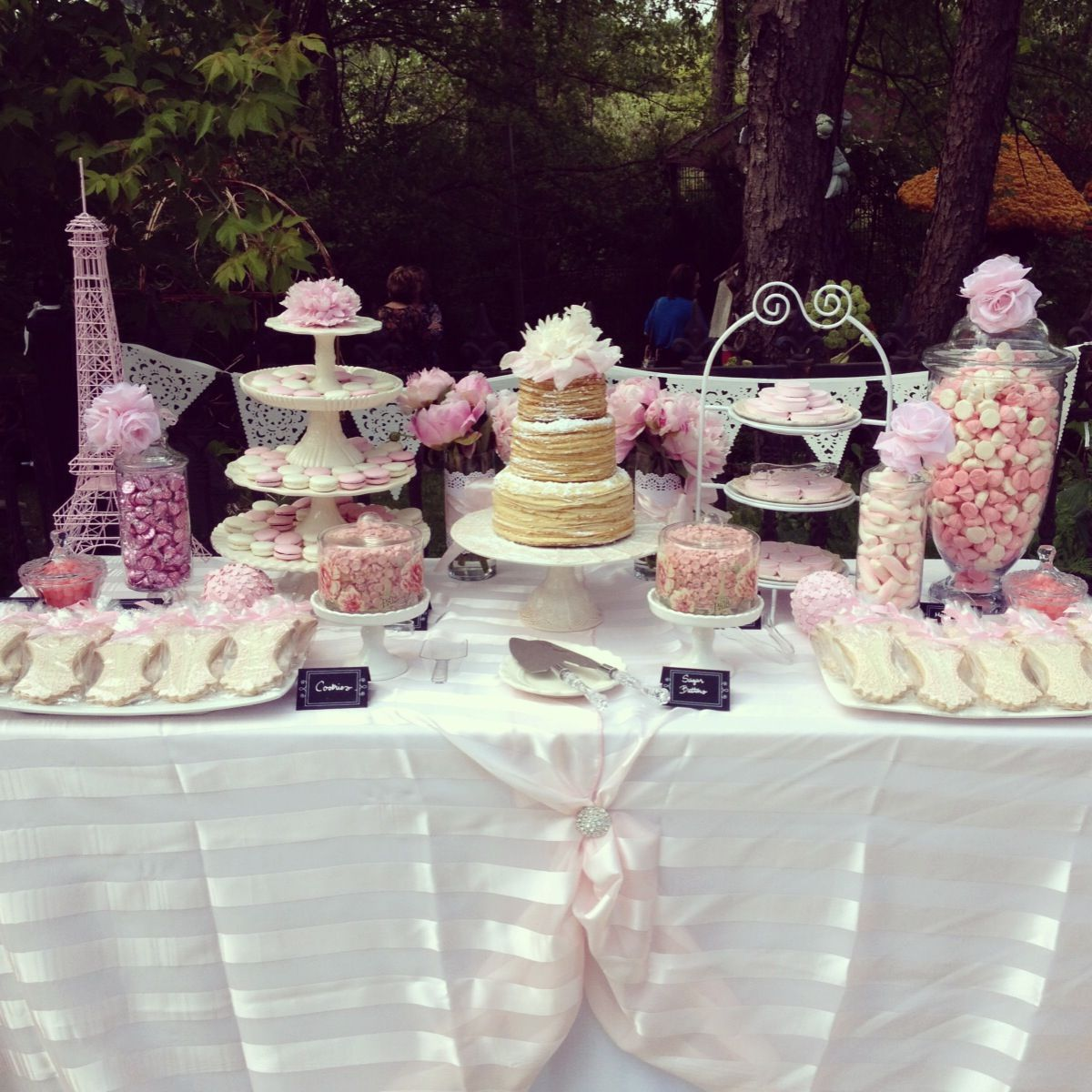 pink and white french themed bridal shower dessert table