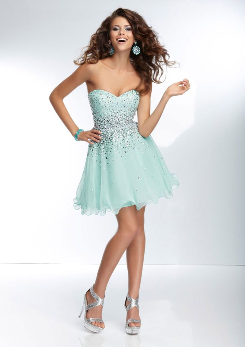 Short dress with a fitted bodice and tulle skirt the bodice of the