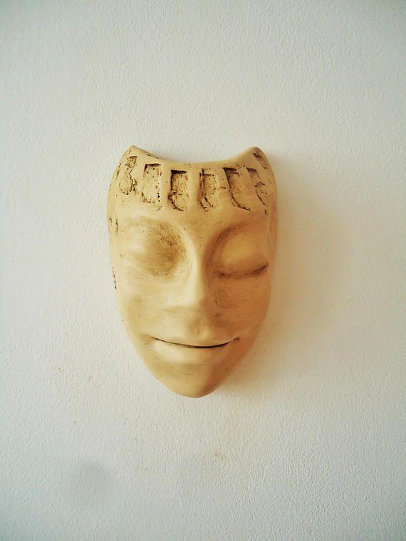 Smiling face mask. Ceramic wall mask. Wall hanging. Contemplating ...