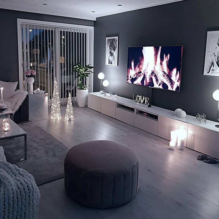 Cozy living room dark wall gray taupe black bright sofa wooden floor…