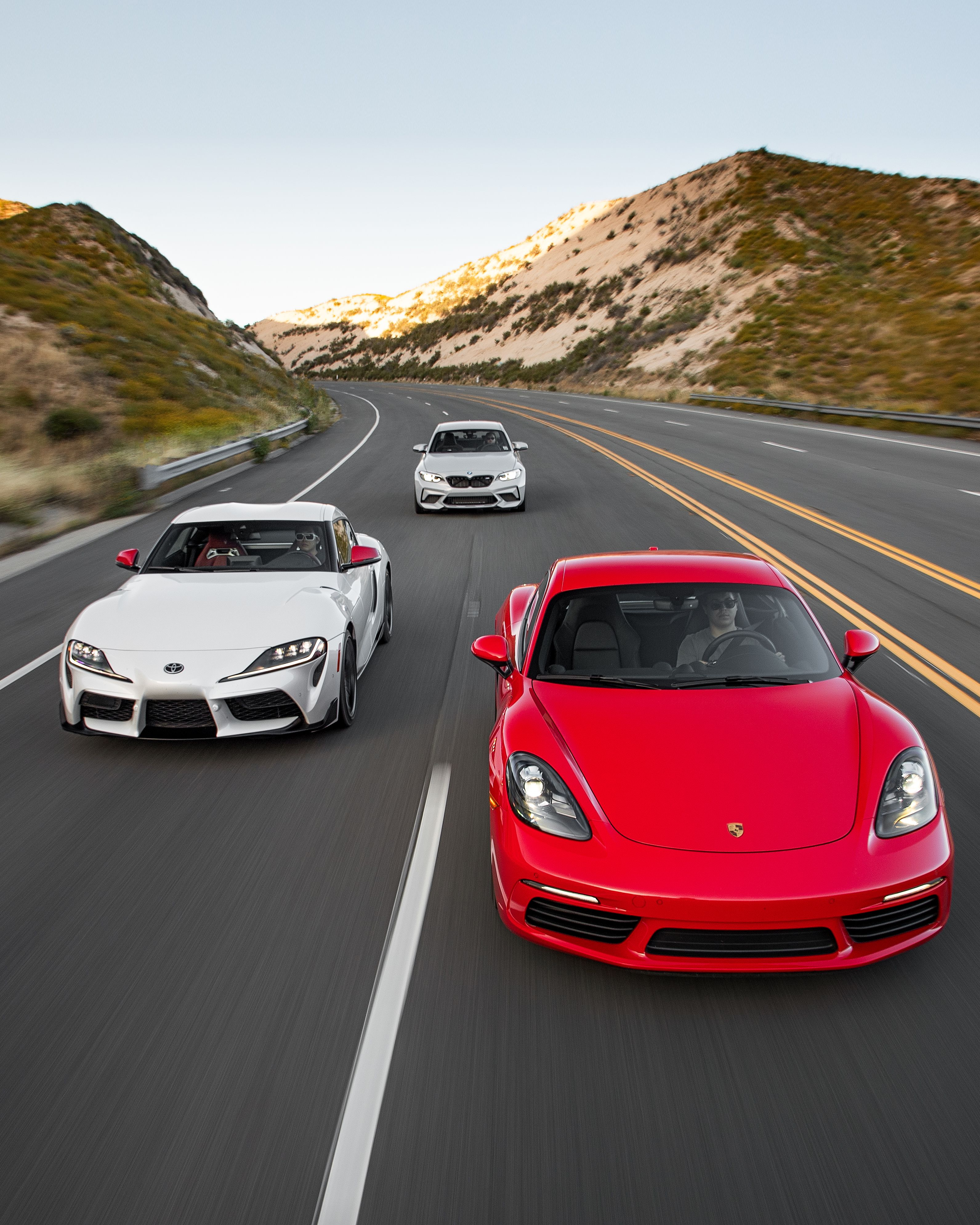 2020 Toyota Supra Vs Porsche 718 Cayman Vs Bmw M2 Competition Sports Car Comparison Toyota Supra Bmw M2 Bmw