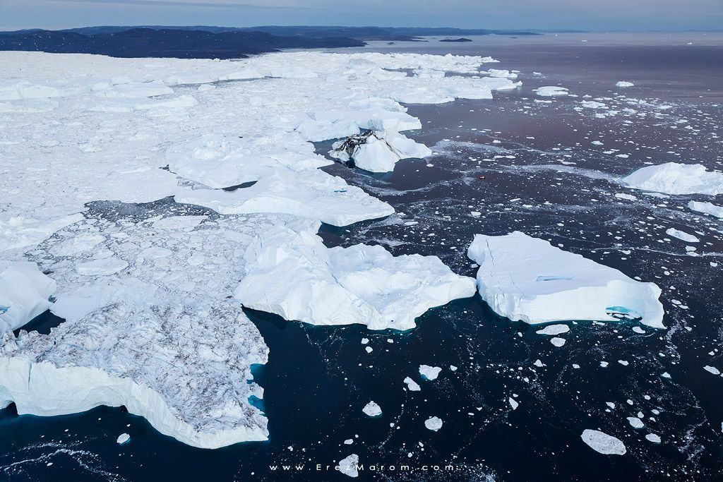 """Free from Kangia - Inconceivably huge icebergs break free of Kangia Fjord, after floating about 60 kilometers from the Ilulissat glacier terminal. Can you spot the fairly large boat? If you'd like to experience and shoot this unbelievable place yourself, see my new '<a href=""""http://www.erezmarom.com/index.php/photography-workshops/view/tales-of-arctic-nights-greenland-summer-photo-workshop"""">Tales of Arctic' Nights </a>  Greenland photo workshop next summer for a week of immense icebergs…"""