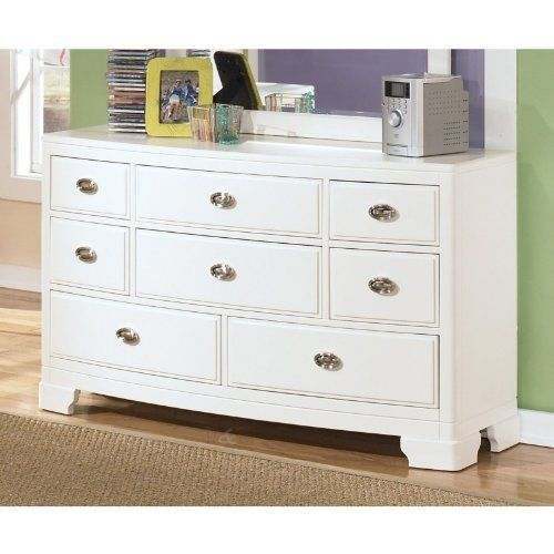 """Contemporary White Children's Dresser by Famous Brand Furniture. $521.91. White finish. Curved case fronts. Made with veneers and hardwood solids in a white finish. Dimensions : 56"""" W x 18.06"""" D x 33.25"""" H. Burnished metallic color hardware. The """"Alyn"""" youth bedroom collection takes a clean white contemporary design with curved case fronts and sleek burnished metallic color hardware and creates a magical collection with function and design options perfect for any decor."""
