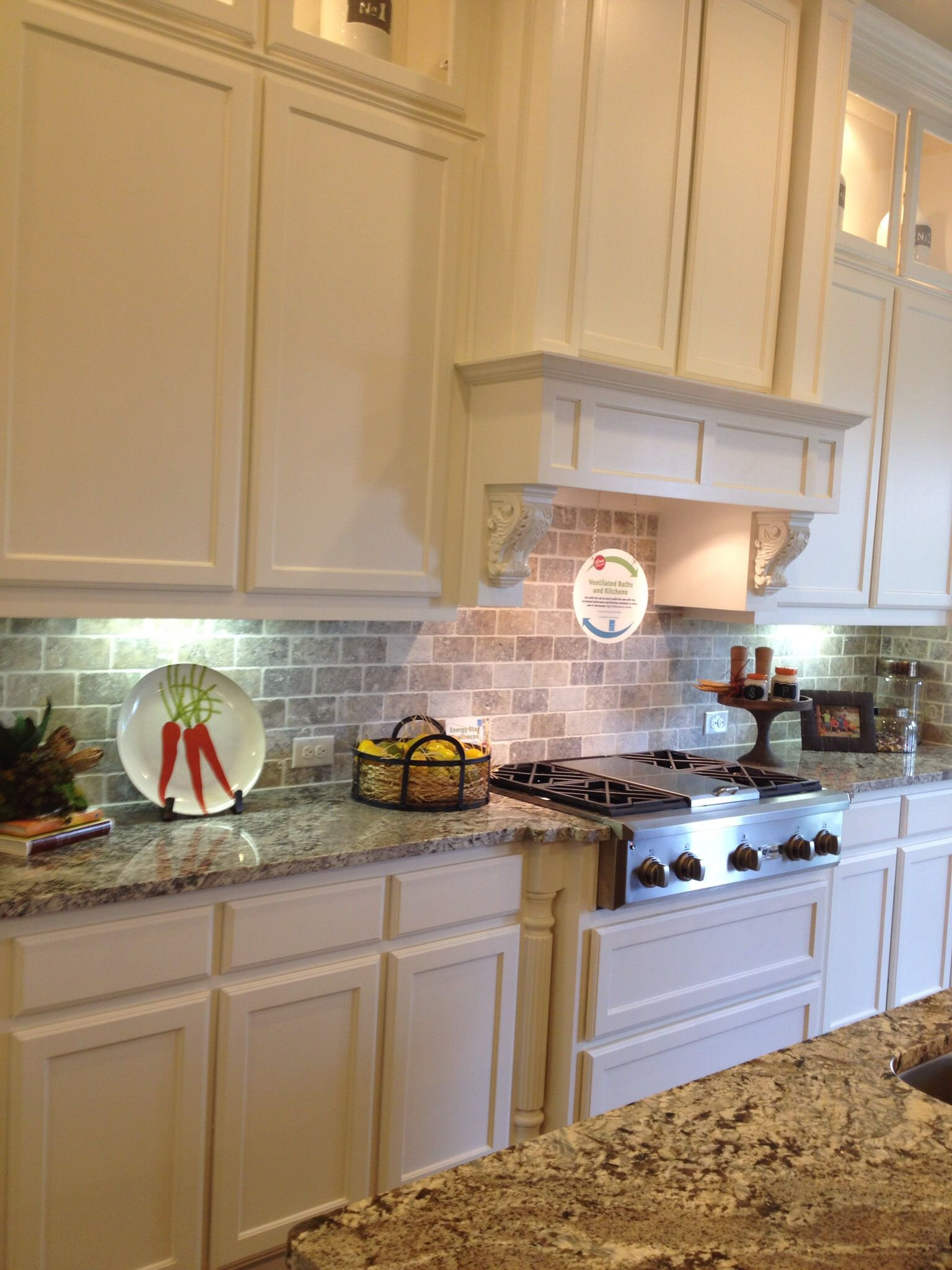 Good kitchen! Stone tile backsplash, white cabinets ...