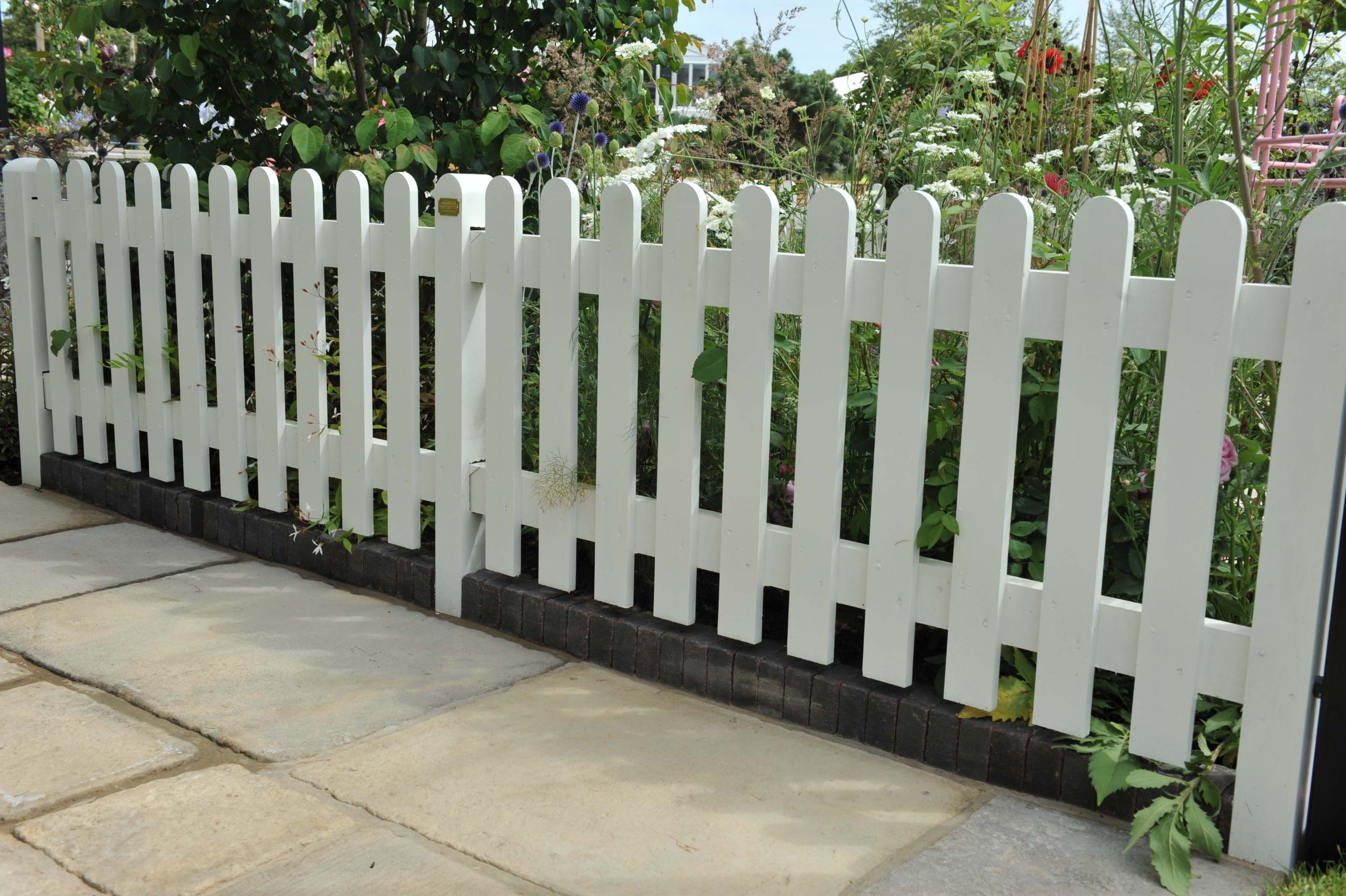 Romantic #garden With Rounded Top Traditional Palisade #fencing Painted  White. Featured In The