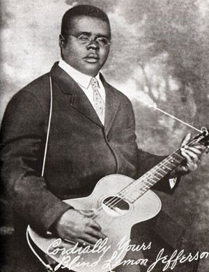 """""""Blind"""" Lemon Jefferson (Lemon Henry Jefferson; September 24, 1893 - December 19, 1929) began playing the guitar in his early teens and soon began performing at picnics and parties near his hometown of Wortham, Texas. He became a street musician, playing in East Texas towns in front of barbershops and on street corners. In the early 1910s, Jefferson began traveling frequently to Dallas, where he met and played with the blues musician Lead Belly. He he was one of the first solo blues…"""