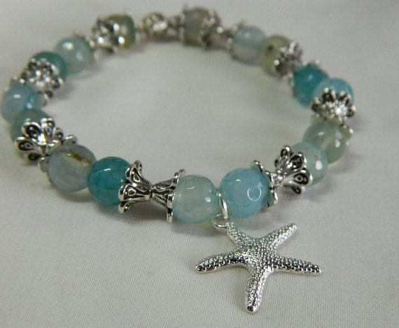 7dff226d2664 Light blue agate stretch bracelet with a silver star fish