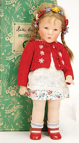 KÄTHE KRUSE doll- fabric head, clearly visible seam back of the head, brown painted eyes, jersey body with stitched knees, original condition., in original box.