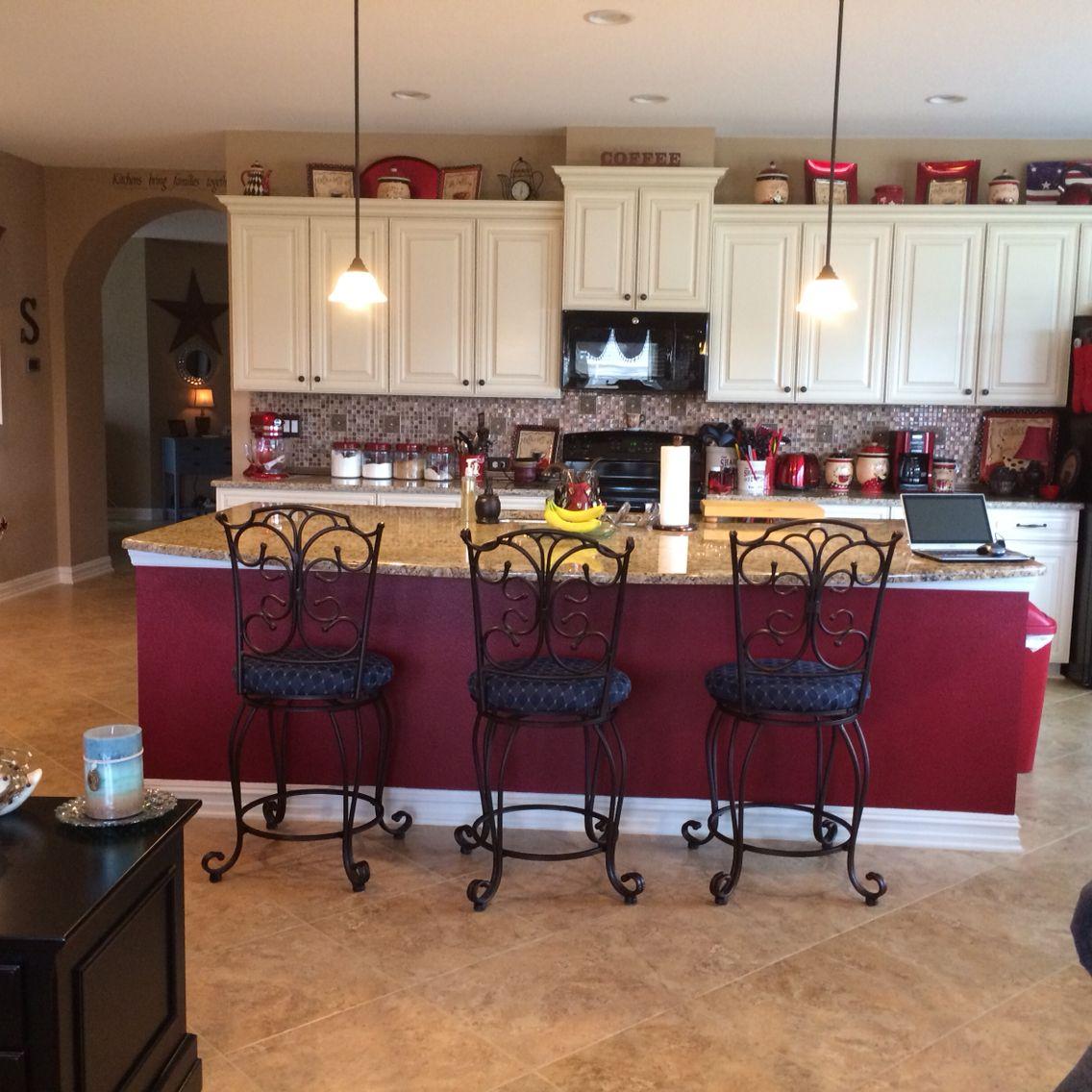 Red island, cream cabinets & New Venetian Gold countertops ...