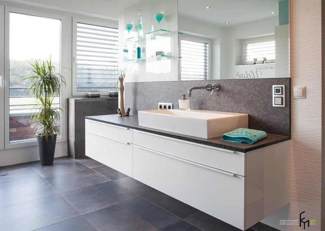 an extraordinary white floating sinks with frameless mirror and charming tosca glass decors for glamorous bathroom with concrete black flooring and stunning statue decor on the sink