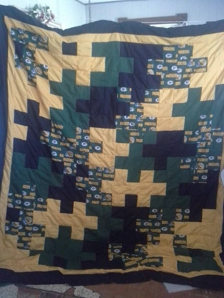 Homemade puzzle piece Packers blanket