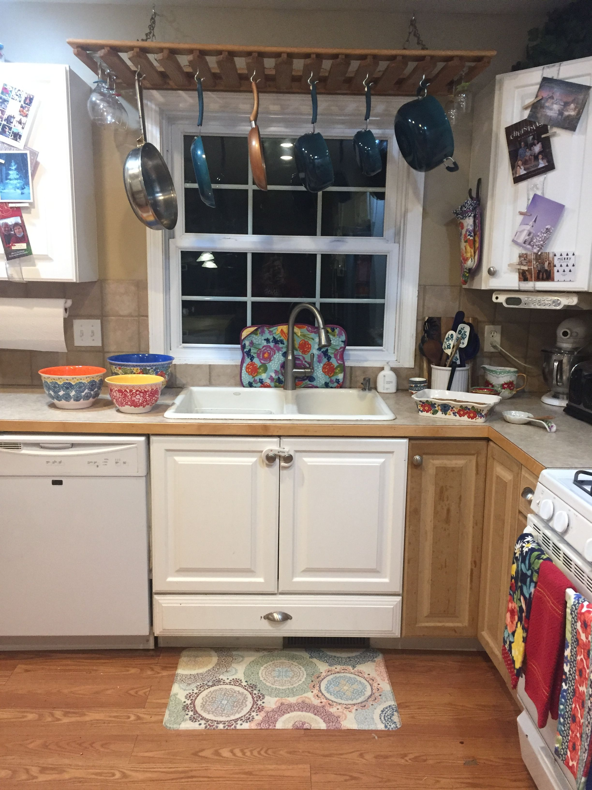 Over the sink hanging pots and wine rack | Pot rack ...