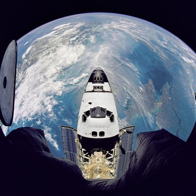 Fish-eye view of the Space Shuttle Atlantis as seen from the Russian Mir space station during the STS-71 mission  #russian #mir #spacestation #atlantis #nasa #space #earth #spaceship #spacetravel #spaceart #spaceinvader #spaceshipearth