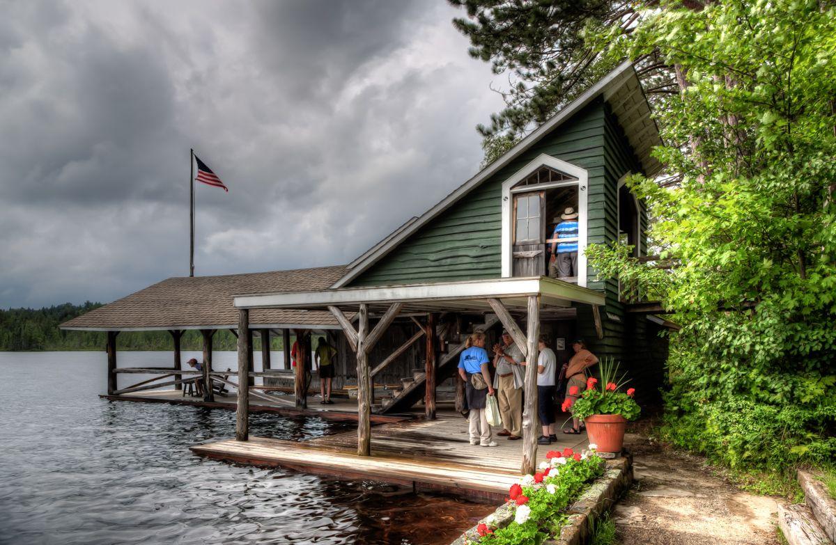 White Pine Camp Boathouse | House styles, House boat ...
