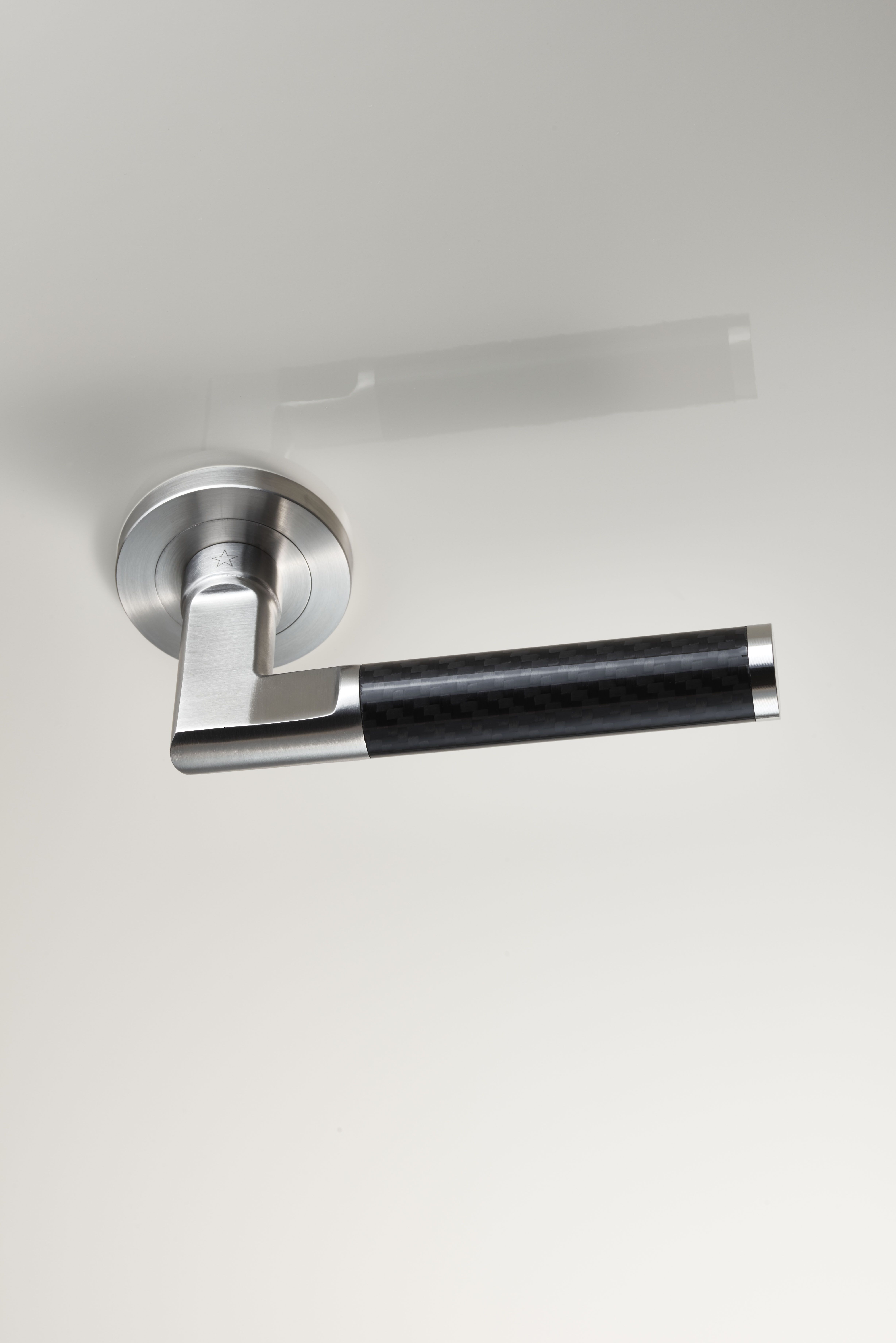 Carbon Fibre Handle On A Concealed Fix Threaded Slim Rose A Straight Round Bar Handle With A Carbon Fiber Midsection Th Modern Door Carbon Fiber Door Handles