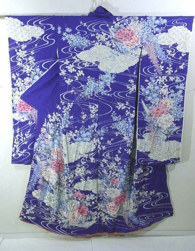 This is a Kimono silk fabric cut into Furisode shape and stitched roughly before sewing to make Furisode.  It has an elegant seasonal flower design of such as large 'Botan'(peony), 'Tsubaki' (camellia) and 'Fuji' (wisteria) on stream, which is dyed