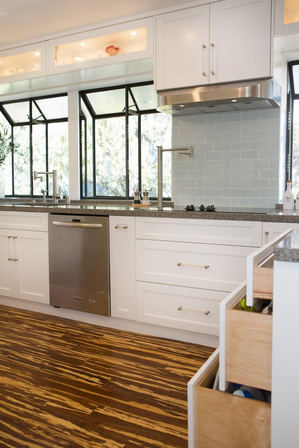 Window under kitchen cabinets  gorgeous angled windows produce a greenhouse feel in this bright and