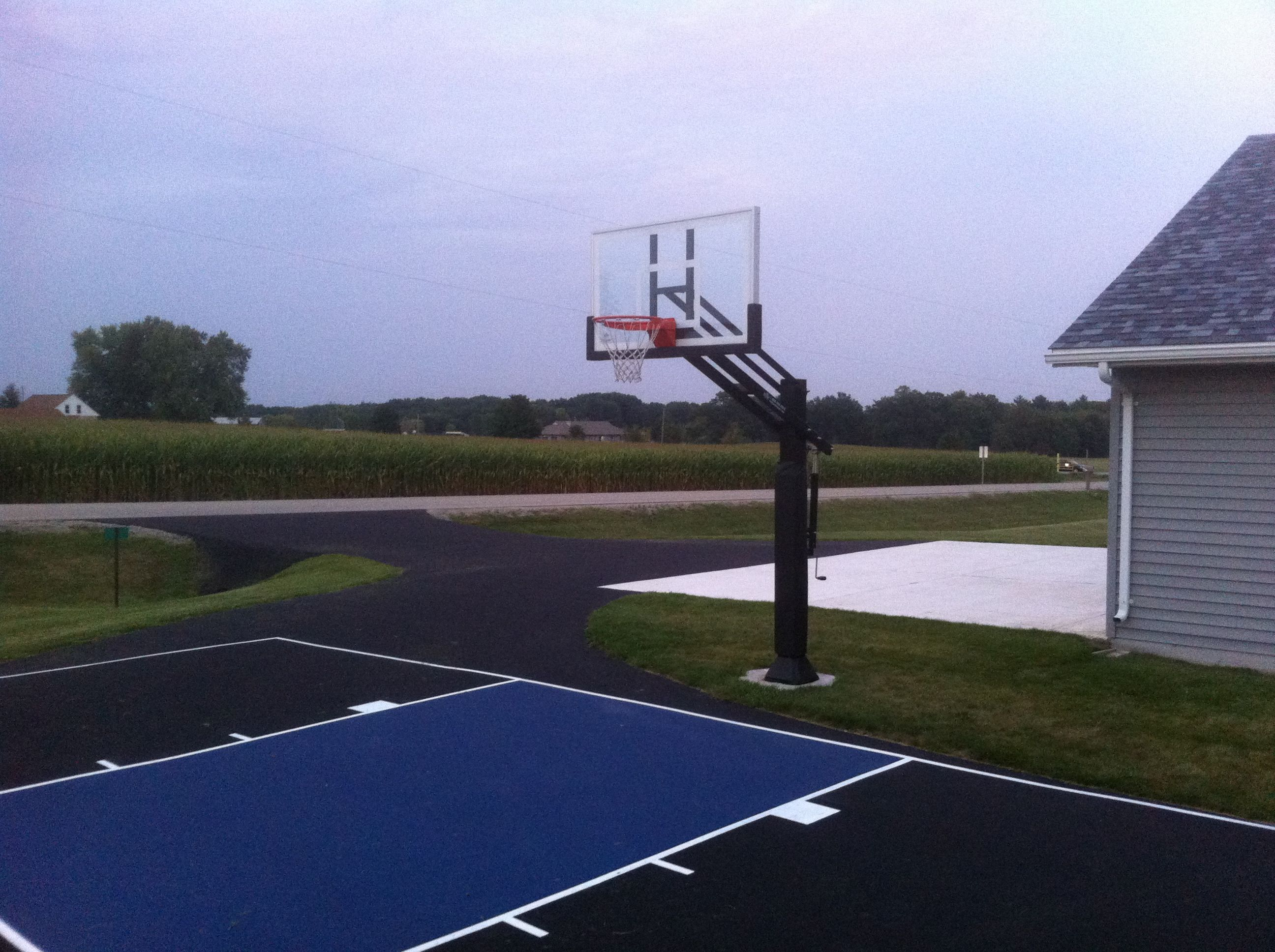 this pro dunk adjustable in ground front yard basketball system does