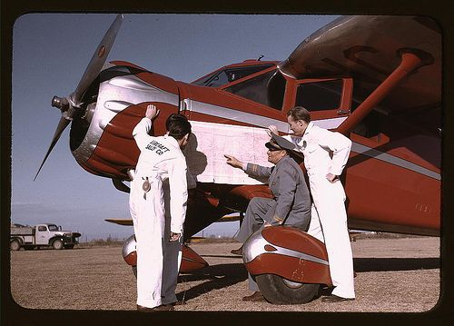 instructor and students studying a map, meacham field, fort worth, tex. (library of congress)