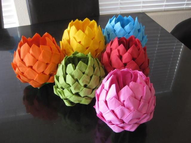HOW TO MAKE PAPER NAPKIN FLOWERS (LOTUS FLOWERS)  Video Tutorial  http://shihoscraftcafe.wordpress.com/2012/03/14/how-to-make-paper-napkin-flowers-lotus-flowers/    How To Fold A Lotus Napkin  http://www.videojug.com/film/how-to-fold-a-lotus-napkin    How to Make an origami lotus flower from a napkin  http://origami.wonderhowto.com/how-to/make-origami-lotus-flower-from-napkin-335905/    Lotus flower made from a napkin…