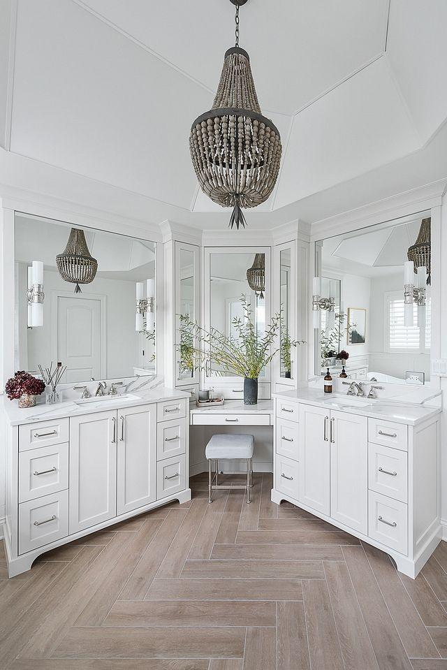 Photo of Bathroom vanity Beautifully designed double vanity that wraps the corner with mi…