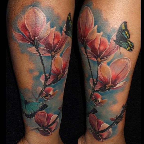 Magnolia Tattoo by Laura Juan love the flowers, not big on the blue background or butterfly