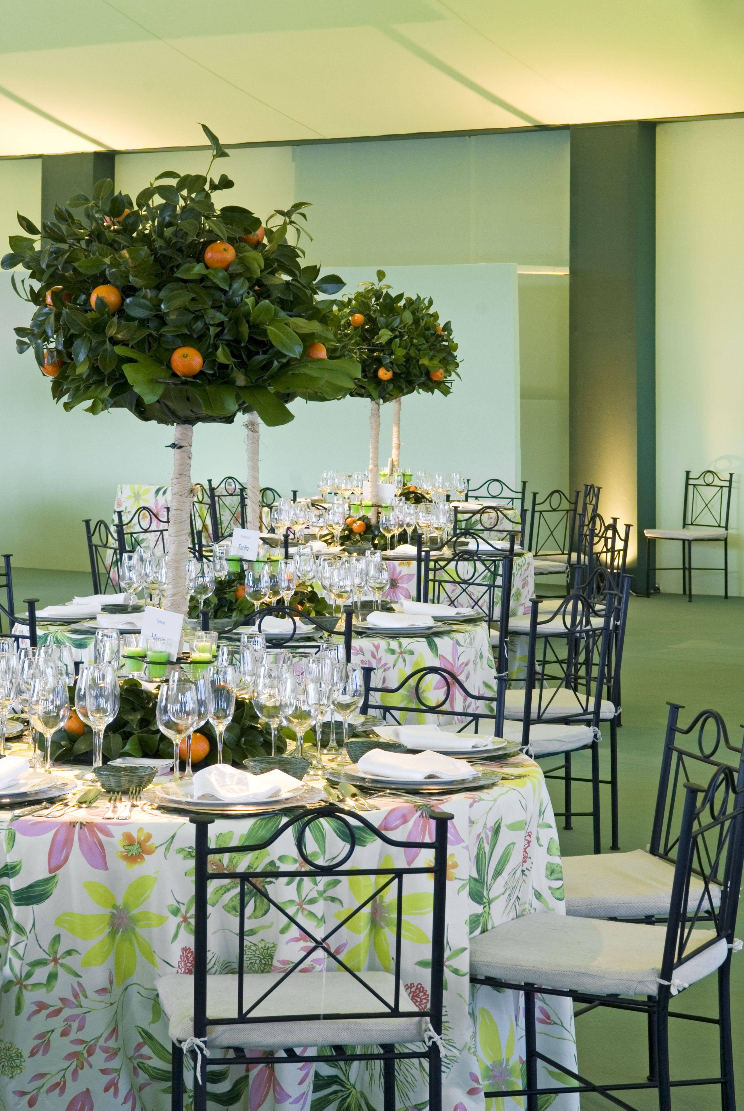 Mesas decoradas con centros con Naranjitos de www.NaranjasKing.com