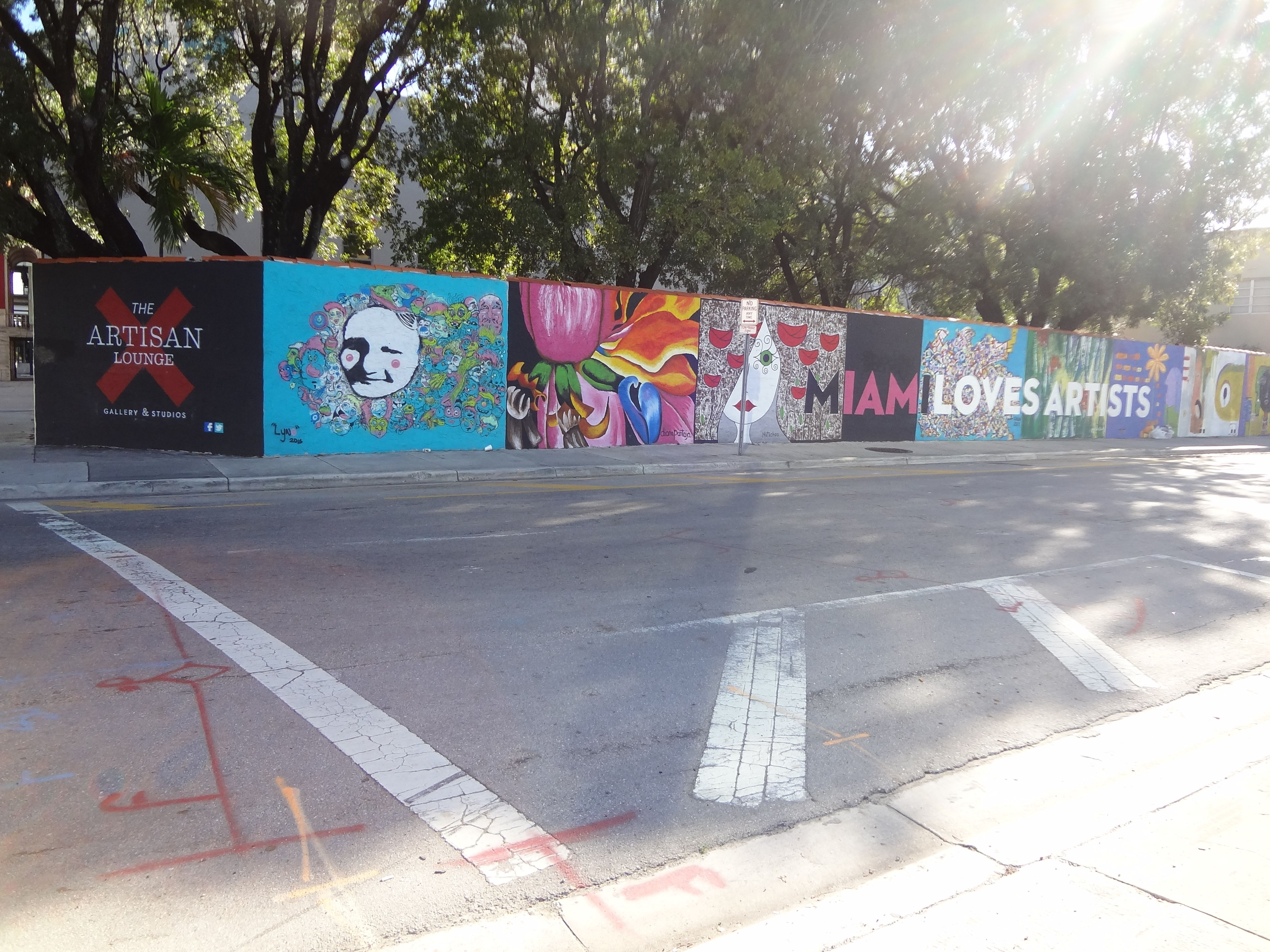 The strip of small murals outside artisan studios and christ fellowship church in downtown miami