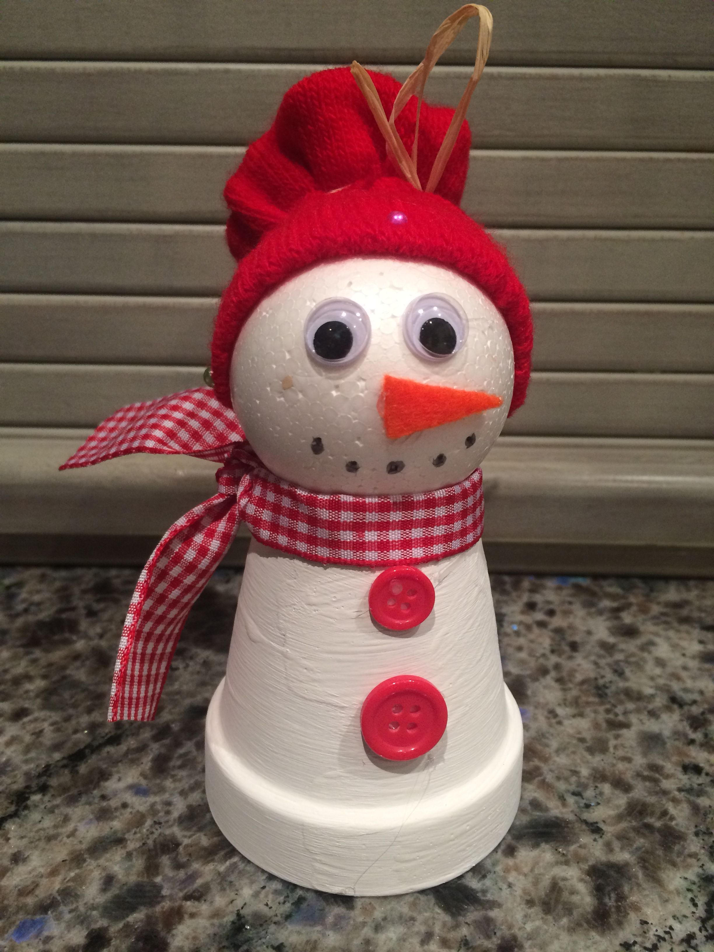 Snowman made with clay pot and Styrofoam ball. A tiny
