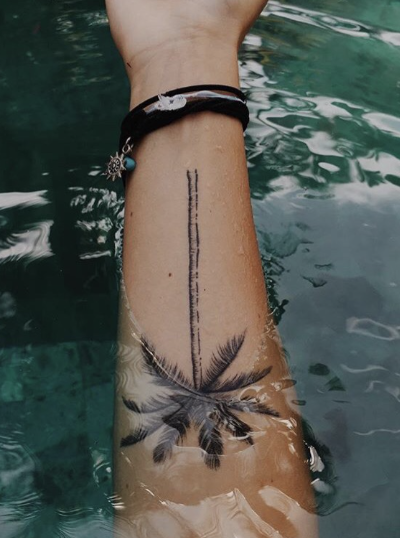 Such a cute tattoo to be smaller and on the ribs! Palm