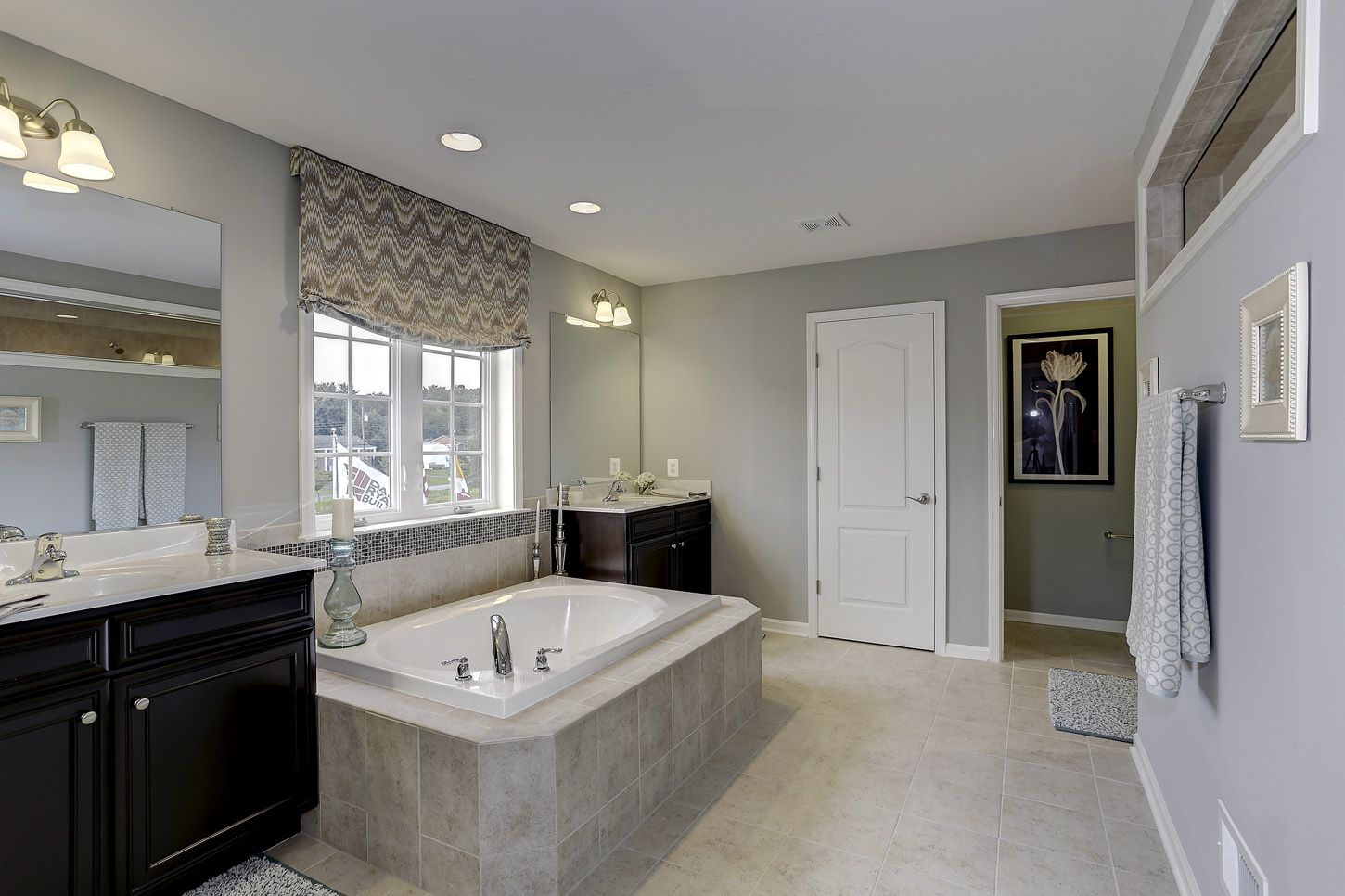 Beautiful owner's bathroom with Jack and Jill couple style bathroom. The Rosecliff II model at Maple Valley Estates by Dan Ryan Builders. Home Style Ideas