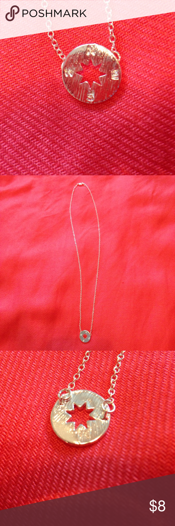 """Silver compass necklace Integrated necklace in brushed silver features the cardinal points of the compass and a starburst punched out of the middle. Chain is 19"""" long. Wear this to remind yourself of which direction you need to head. Great for travel fans. Jewelry Necklaces"""