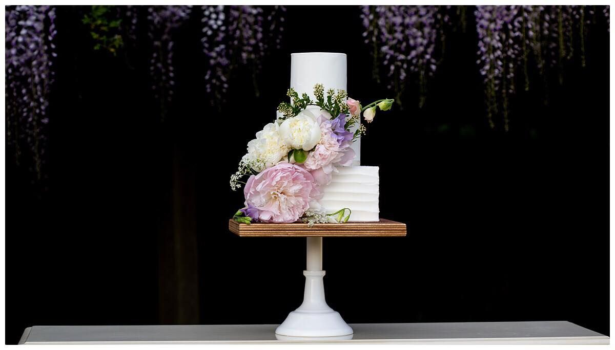 Buttercream and fondant wedding cake with fresh flowers one tier