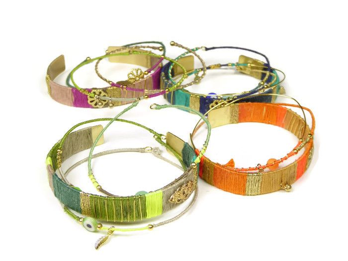 Beautiful gold plated fashionable bangle bracelet with silk and gold plated charms and accents. Handmade in Amsterdam by www.sophisticatedgold.nl