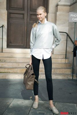 This model layers basics for a simple, menswear-inspired vibe. We're digging her button-down peeking out from #classic gray sweatshirt and classic loafers—some pieces are perennially in style.