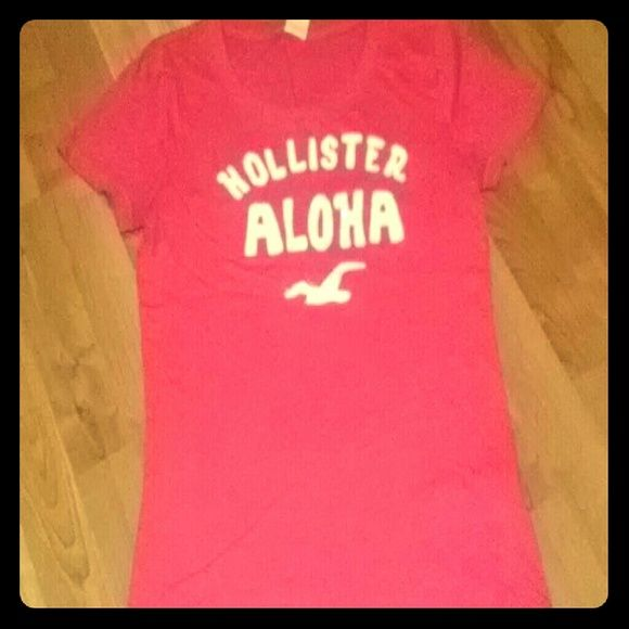 Pink t-shirt This a Hollister short sleeve t-shirt with a scoop neckline. It has Hollister Aloha in white letters and their bird trademark in white too. The aloha lettering has clear embellishments on it. It is 60% cotton and 40% polyester and machine wash cold and tumble dry low. In very good condition and no holes or stains. Hollister Tops